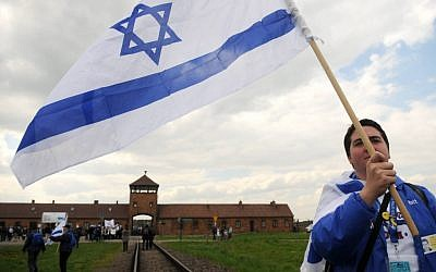 "An Israeli young woman waves the Israeli flag as she participates with hundreds of other Israeli youth in ""the March of the Living"" tour which involves visiting concentration and death camps in Poland. May 02, 2011. (photo credit: Yossi Zeliger/Flash90)"