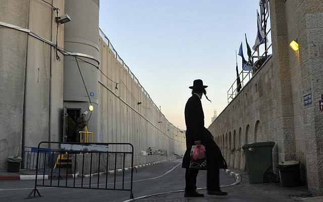 An ultra-Orthodox man within the heavily fortified space of Rachel's Tomb (Sege Attal/Flash 90)