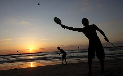 Israelis play paddle-ball at the beach  in Tel Aviv. July 05, 2011. (photo credit: Miriam Alster/Flash90)