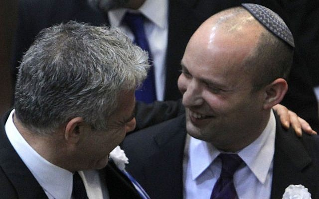 Yair Lapid (left) and Naftali Bennett at the Knesset's swearing-in ceremony in February 2013 (photo credit: Miriam Alster/Flash90)