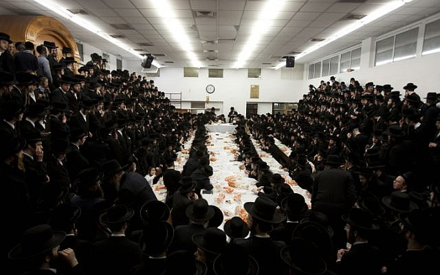 Ultra-Orthodox Jews from a Hassidic dynasty celebrate as they sit with their rabbis around a long table in a ultra-Orthodox neighborhood in Jerusalem, February 2012. (photo credit: Yonatan Sindel/Flash90)