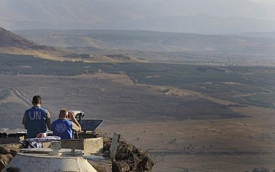UN peacekeepers monitor the Syrian side of the border from an Israeli army post at Mount Bental near Kibbutz Merom Golan in the Golan Heights in July 2012. (photo credit: Tsafrir Abayov/Flash90)