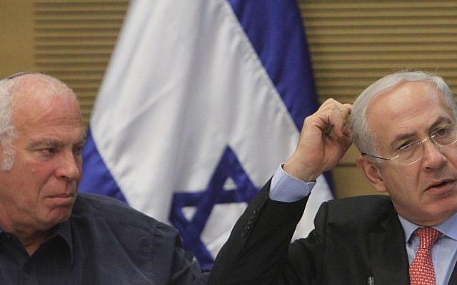Uri Ariel (left) with Benjamin Netanyahu in the Knesset in 2012 (photo credit: Miriam Alster/Flash90)
