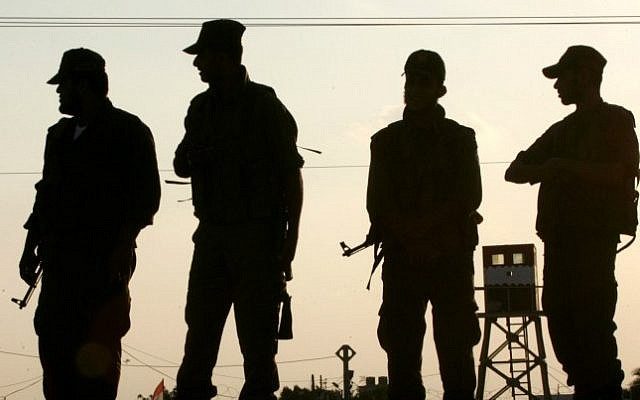 Hamas security officers stand guard in the southern Gaza Strip in October 2012. (photo credit: Abed Rahim Khatib/Flash 90)