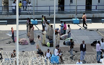 African immigrants seen at a detention facility located in the south of Israel. August, 2012. (photo credit: Moshe Shai/Flash90)