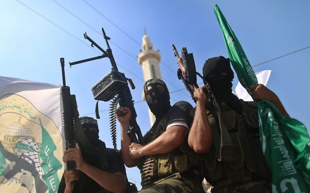 Hamas terrorists in Gaza pose on anniversary of prisoner exchange deal for Gilad Shalit. October 18, 2012 (photo credit: Wissam Nassar/Flash90)