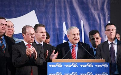 Prime Minister Benjamin Netanyahu alongside senior Likud party members after the announcement of the party primary results on November 26, 2012. (Flash90)