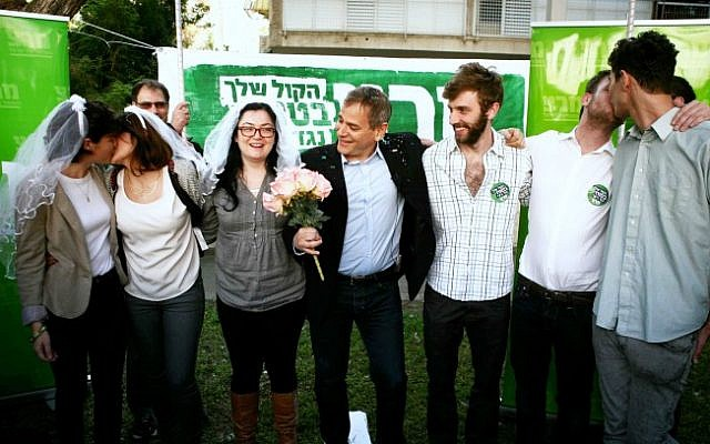 Meretz MK Nitzan Horovitz (center) and members of the Meretz party seen acting out a gay marriage outside the Rabbinical Court in Tel Aviv, March 2013 (photo credit: Flash90)