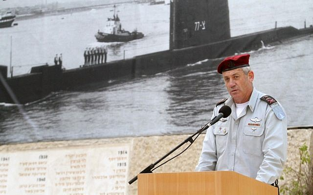 IDF chief Benny Gantz speaking in front of a picture of the Dakar at a memorial ceremony in in January. (photo credit: Yoav Ari Dudkevitch /Flash90)