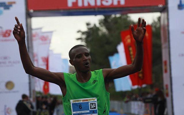 Abraham Kabeto Katale of Ethiopia crosses the finish line first at the Jerusalem marathon on Friday (photo credit: Yossi Zamir/Flash90)