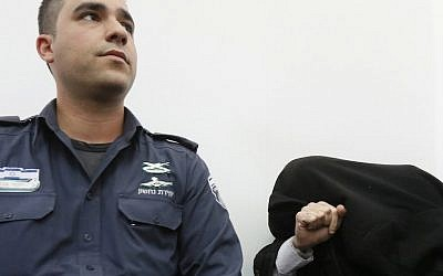 A man suspected of pedophilia at a court hearing in Jerusalem. Police are often able to build cases against pedophiles by a forensic analysis of their computers (photo credit: Kobi Gideon/Flash90)