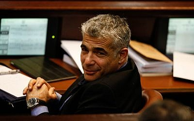 Yesh Atid leader Yair Lapid at the assembly hall of the Knesset in Jerusalem on February 12 (photo credit: Flash90)