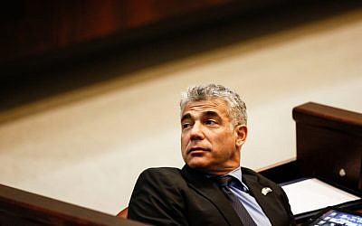Yair Lapid, leader of the Yesh Atid party, in the Knesset in Jerusalem, February 2013. (photo credit: Flash90)