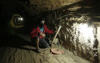A Palestinian works inside a smuggling tunnel, beneath the Egyptian-Gaza border in Rafah, in the southern Gaza Strip, February 19, 2013. (photo credit: Abed Rahim Khatib/Flash90)
