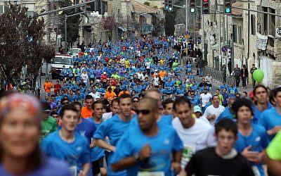 Runners take part in the third international Jerusalem marathon on Friday (photo credit: Yonatan Sindel/Flash90)
