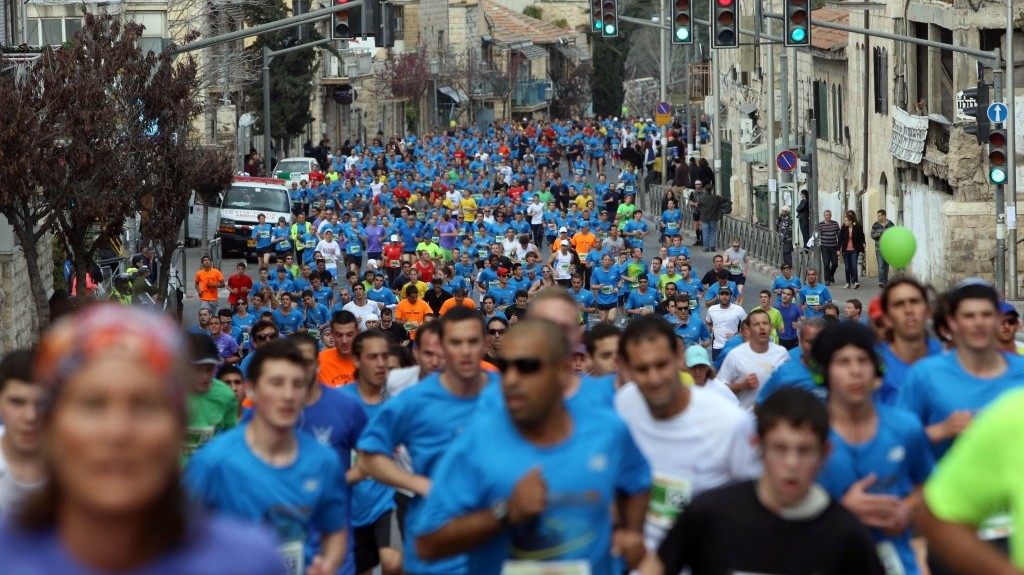 Runners take part in the third international Jerusalem marathon on Friday (photo credit: Yonatan Sindel/Flash90)