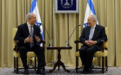President Shimon Peres (right) meeting Likud chairman Prime Minister Benjamin Netanyahu over the latter's efforts to assemble a coalition following the January 2013 elections. (photo credit: Kobi Gideon/Flash90)