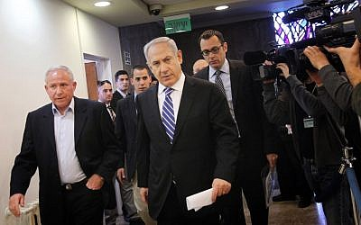 Benjamin Netanyahu (center), arriving at the Cabinet meeting Sunday with Minister Avi Dichter. (photo credit: Miriam Alster/Flash90)