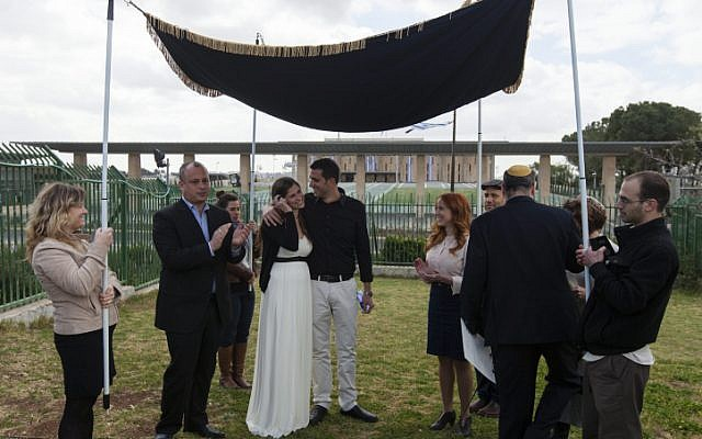 MK Stav Shaffir (to the right of wedding couple) participates in a Reform Jewish wedding ceremony in front of the Knesset, in protest of the Orthodox rabbinate's monopoly on marriage licensing and the lack of civil marriage in Israel. (Flash90)