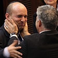 Yair Lapid (R) seen with Naftali Bennett during a plenum session in the Israeli parliament, March 2013 (photo credit: Isaac Harari/Flash90)
