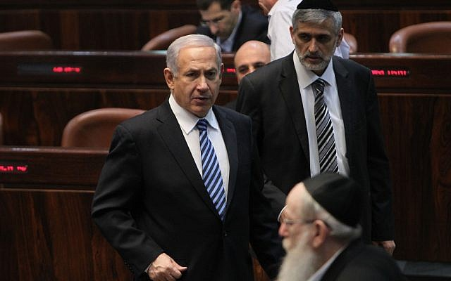 Benjamin Netanyahu seen with Shas's Eli Yishai (back right) and United Torah Judaism's Yaakov Litzman (foreground) in the Knesset on March 18, 2013. Photo by Miriam Alster/Flash90)