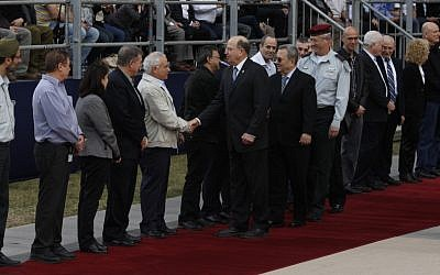 New Minister of Defense Moshe Ya'alon and his predecessor Ehud Barak shake hands with commanders at the ceremony in which Ya'alon replaced Barak. (photo credit: Flash 90).