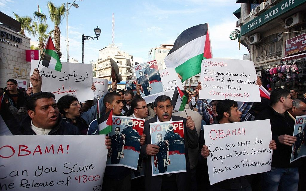 Palestinians hold placards during a demonstration against the visit of US President Barack Obama to the Palestinian territories in the West Bank city of Ramallh, on March 19, 2013 (photo credit: Issam Rimawi/Flash90)