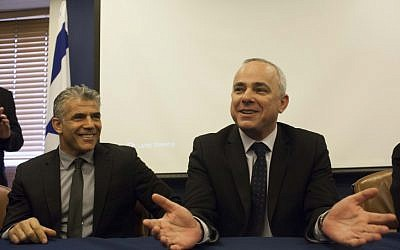 Outgoing Finance minister Yuval Steinitz (Likud) on the right welcomes incoming minister Yair Lapid (Yesh Atid), March 19 2013. (photo credit:Yonatan Sindel/Flash90)