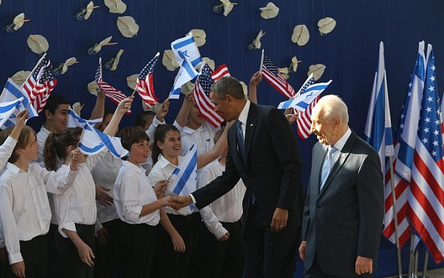 US President Barack Obama and Israeli President Shimon Peres are greeted by children outside the President's Residence in Jerusalem on March 20, 2013. (Amit Shabi/Flash90)