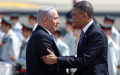 Prime Minister Benjamin Netanyahu greets President Barack Obama at Ben-Gurion Airport during Obama's visit to Israel in 2013 (photo credit: Miriam Alster/Flash90)