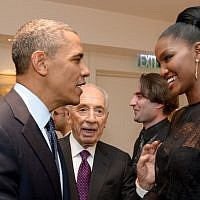 US President Barack Obama, left, shake hands with Yityish 'Titi' Aynaw, a 21-year old Ethiopian-Israeli woman who was the first Ethiopian-born woman to be crowned Miss Israel, at the presidential residence in Jerusalem, in March 2013, as President Shimon Peres (center) looks on. (photo credit: Avi Ohayon/Flash90)