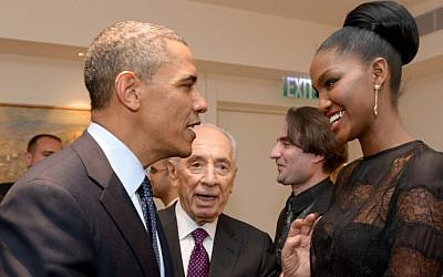 President Barack Obama shakes hands with Yityish Aynaw, a 21-year old Ethiopian-Israeli who won Israel's Miss Israel national beauty pageant, at the President's Residence in Jerusalem on March 21, 2013. (Photo credit: Avi Ohayon/GPO/FLASH90)
