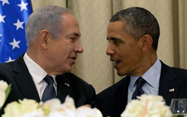 President Barack Obama, right, talks with Prime Minister Benjamin Netanyahu at a state dinner in Obama's honor in March 2013, at the President's Residence in Jerusalem. (photo credit: Avi Ohayon/Flash90)