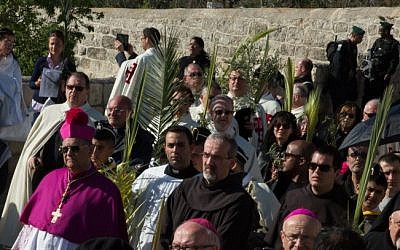 Latin Patriarch of Jerusalem Fouad Twal leads Christian pilgrims in the traditional Palm Sunday procession on the Mount of Olives, overlooking Jerusalem's Old City, Sunday (photo credit: Sarah Schuman/Flash90)