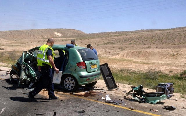 Police investigate the scene of a car accident in which two people were killed March 27 on Route 40, in the south of Israel (photo credit: Dudu Greenspan/Flash90)