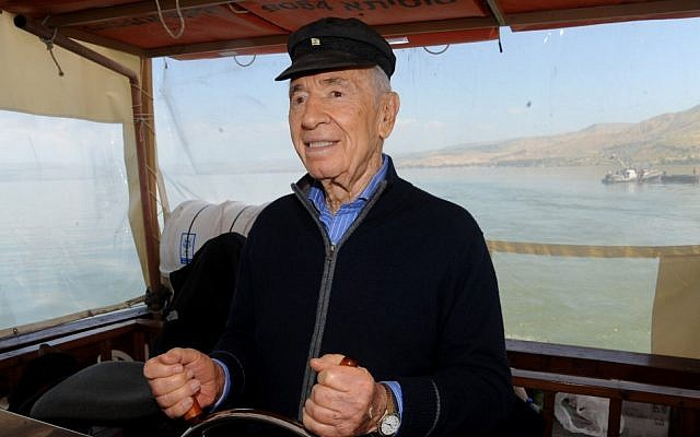 President Shimon Peres steering the boat 'The Sussita' on the Sea of Galilee on March 28, 2013. (photo credit: Gil Eliyahu/Flash 90)