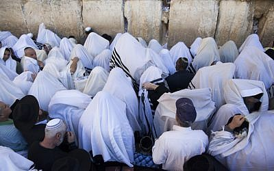 Illustrative photo of Tallit-clad worshipers at prayer in front of the Western Wall (photo credit: Yonatan Sindel/Flash90)