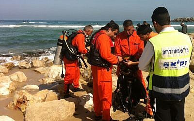 Illustrative photo of rescue and medical personnel at an Israeli beach (photo credit:  ZAKA/Flash90)