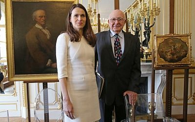 French Culture Minister Aurelie Filippetti returned six stolen paintings to American heir Thomas Selldorff at Tuesday's ceremony. (Michel Euler/AP)