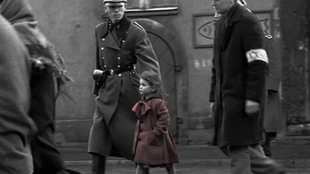"""The actress who played the girl in red in """"Schindler's List"""" as a 3-year-old says seeing the film was traumatic. (YouTube screenshot)"""