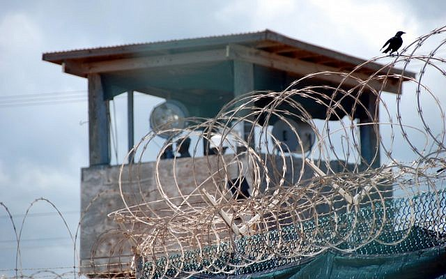 A guard stands duty in a tower over Guantanamo Bay's Detention Camp Delta, in 2007 (photo credit: Army Sgt. Joseph Scozzar/Public Domain)