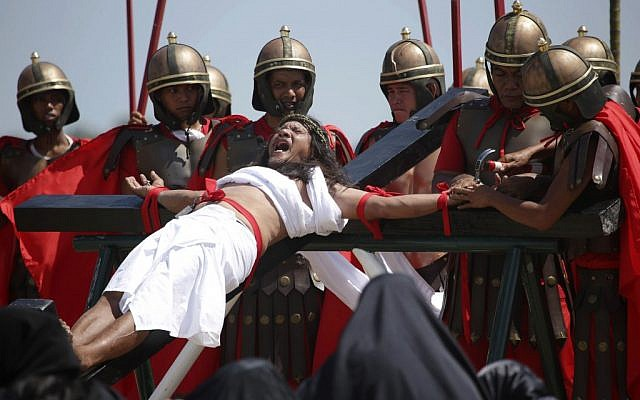 Filipino penitent Ruben Enaje, who has portrayed as Jesus Christ for 27 times, grimaces as he is nailed to the cross during Good Friday rituals on March 29, 2013 at Cutud, Pampanga province, northern Philippines (AP Photo/Aaron Favila)