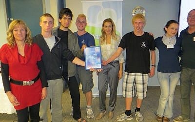 Members of the winning team show off their Certificate of Achievement (photo credit: Courtesy Amal Group)