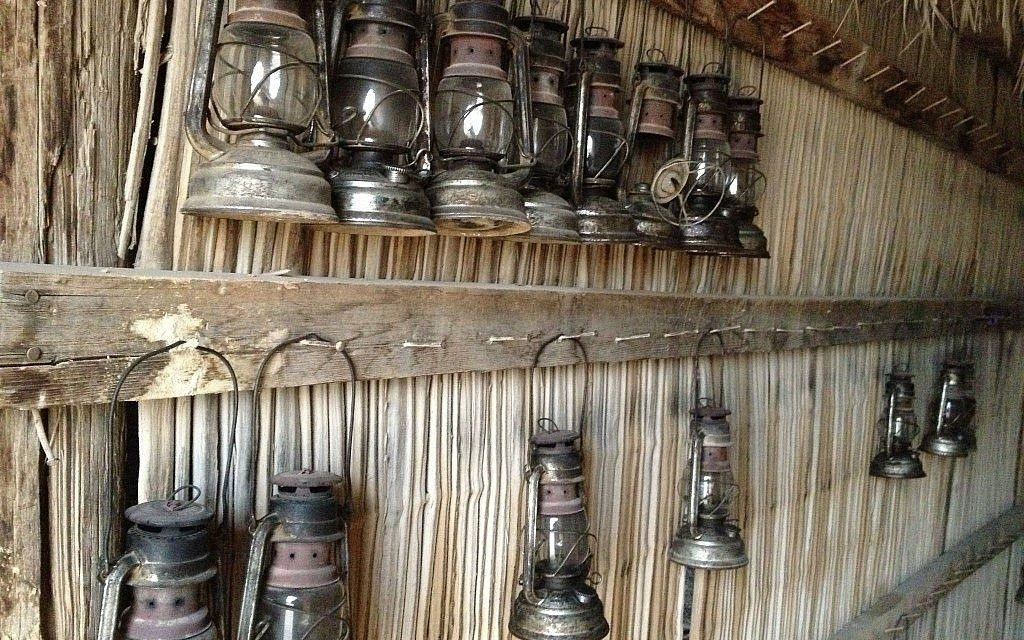 A wall of lanterns at Beerotayim, a rustic campsite in Ezuz, one of the villages in Nitzana (photo credit: Jessica Steinberg/Times of Israel)