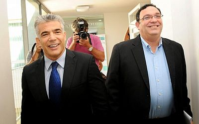Shai Piron, right, of Yesh Atid, with party leader Yair Lapid in October. Piron's endorsement boosted moderate David Stav in his bid to reform Israel's religious bureaucracy (Photo credit: Ben David/Flash90)