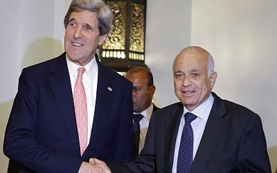 US Secretary of State John Kerry, left, poses for a photograph with Arab League Secretary General Nabil Elaraby, after their meeting in Cairo, Egypt on Saturday. (photo credit: AP Photo/Jacquelyn Martin)
