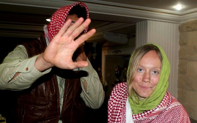 Amir Omar Hassan, left, and Ingvild Selvik Ask, who were abducted by Bedouin gunmen last week, are seen after their release Monday at police headquarters in el-Arish, Egypt (photo credit: AP/Khaled Kandil)