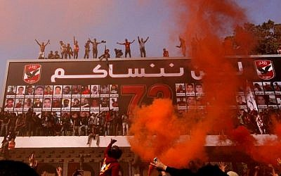 Egyptian soccer fans of Al-Ahly club celebrate in front of their club in Cairo, Egypt, Saturday, March 9. (AP Photo/Amr Nabil)