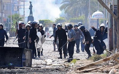 Riot police clash with protesters in Port Said, Egypt (photo credit: AP Photo)