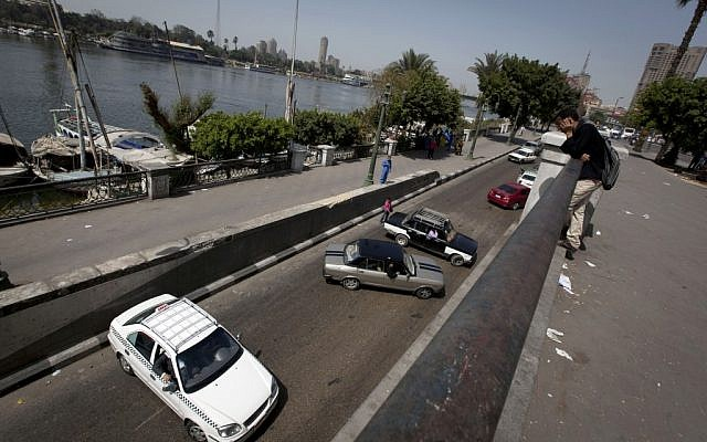 Egyptian motorists turn back with their vehicles after protesters closed the main street by the Nile river in downtown Cairo, Egypt, Sunday, March 10, 2013  (Photo credit: AP/Nasser Nasser).
